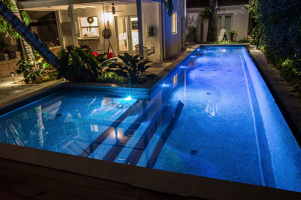LED SAVI lighting, pebble finish, lap pool option, shallow lounging area and infinity edge