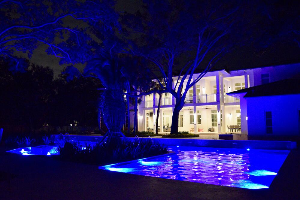 Pool with blue LED lights by Reef Tropical