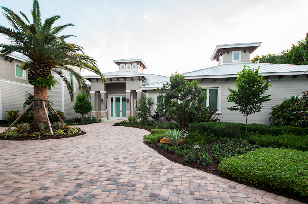 Reef Tropical installs landscape, hardscape and water features throughout South Florida.